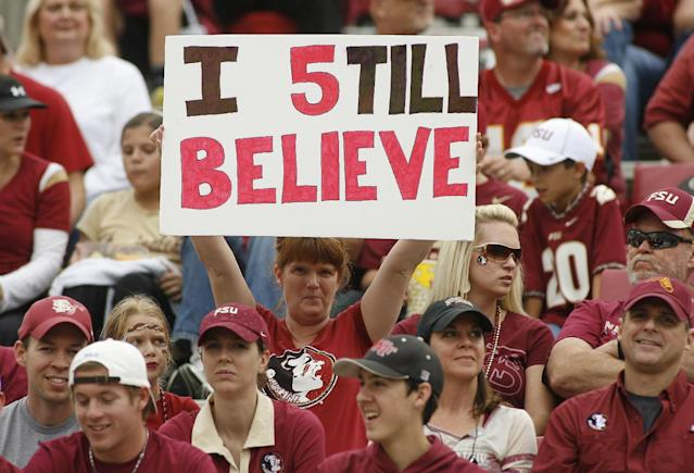 A Florida State fan holds up a sign in support of Florida State quarterback Jameis Winston before the start of an NCAA college football game against Syracuse on Saturday,Nov. 16, 2013, in Tallahassee, Fla. (AP Photo/Phil Sears)