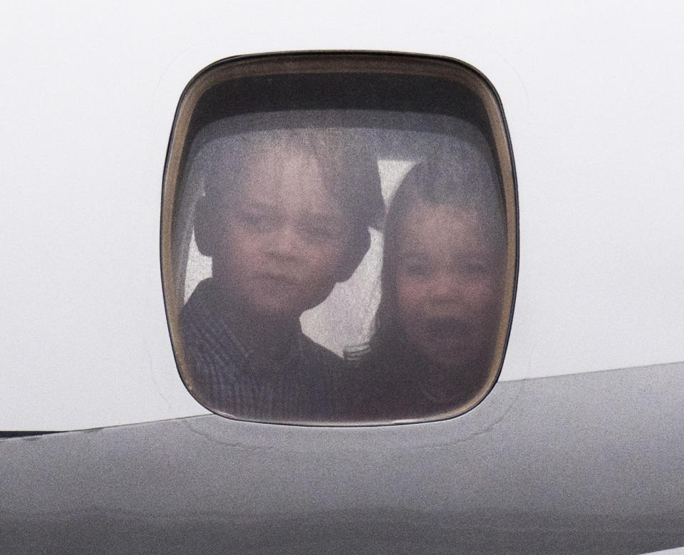 <p>George and Charlotte peer out of the plane as they landed in Warsaw, Poland, in 2017, on tour with their parents. (Arthur Edwards)</p>