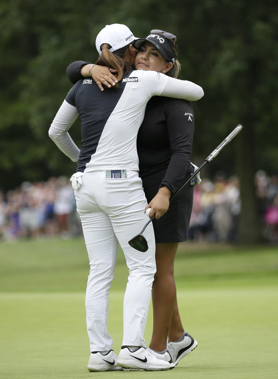 Lizette Salas of the United States, right, embraces, Korea's Ko Jin-young on the 18th green after finishing the final round of the Women's British Open golf championship at Woburn Gold Club near near Milton Keynes, England, Sunday, Aug. 4, 2019. (AP Photo/Tim Ireland)
