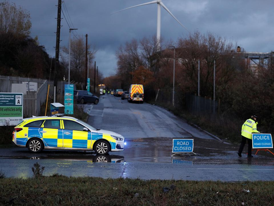 <p>Police closed a nearby road while a helicopter looked for missing people</p>Peter Nicholls/Reuters