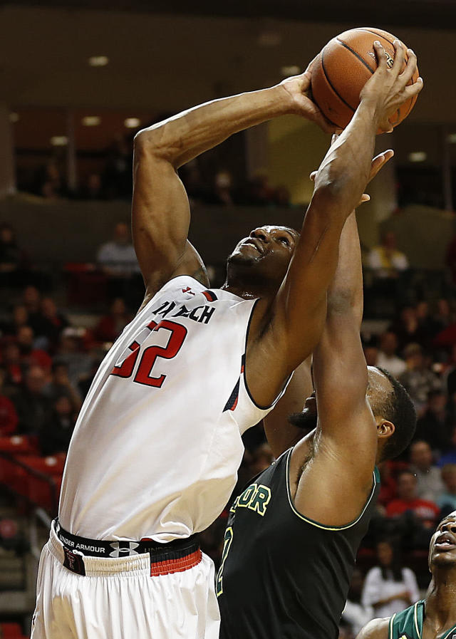 Texas Tech's Jordan Tolbert, left, shoots over Baylor's Rico Gathers during their NCAA college basketball game in Lubbock, Texas, Wednesday, Jan, 15, 2014. (AP Photo/Lubbock Avalanche-Journal, Tori Eichberger)