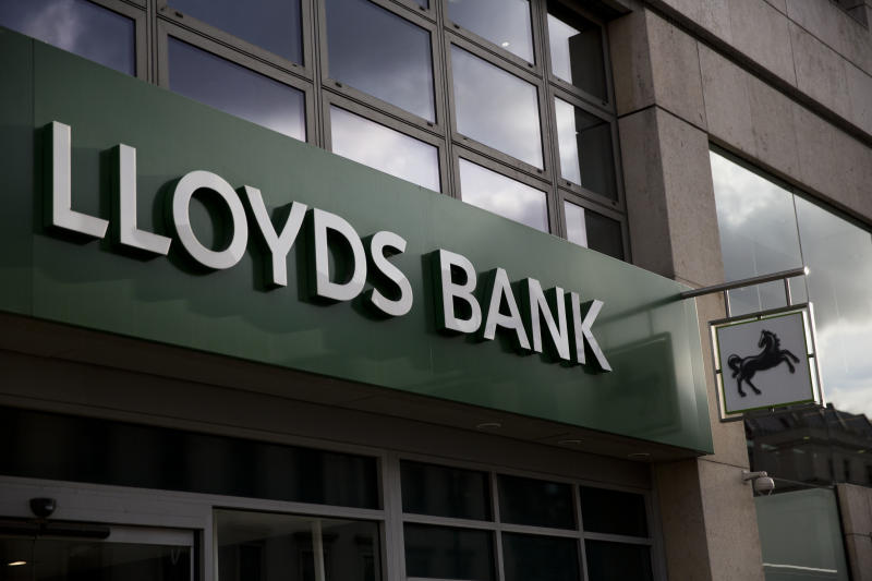 A logo is displayed outside a branch of Lloyds bank on the Strand in central London, Friday, Feb. 27, 2015. London-based Lloyds Banking Group passed a milestone Friday in its recovery from the financial crisis, reporting an annual profit and announcing plans to pay a dividend for the first time since it was rescued by British taxpayers. The bank posted net income of 1.13 billion pounds ($1.7 billion) compared with a loss of 838 million pounds in 2013. The bank plans to pay a dividend of 0.75 pence per share, resulting in a total payout of 535 million pounds. (AP Photo/Matt Dunham)