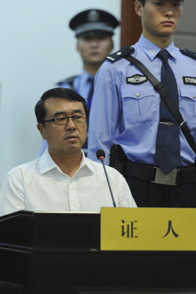 In this photo released by Jinan Intermediate People's Court, former Chongqing city police chief Wang Lijun testifies at a trial of former Politburo member and party leader Bo Xilai at Jinan Intermediate People's Court in Jinan, in eastern China's Shandong province, Saturday, Aug. 24, 2013. Disgraced Chinese politician Bo Xilai told a court Saturday his wife stole government funds without his involvement and revealed how the couple became estranged after he had been unfaithful, offering a glimpse in his politically charged trial of the unraveling of one of China's elite families. (AP Photo/Jinan Intermediate People's Court)