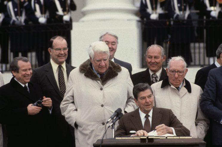 President Reagan signs the Social Security reform bill in 1983.