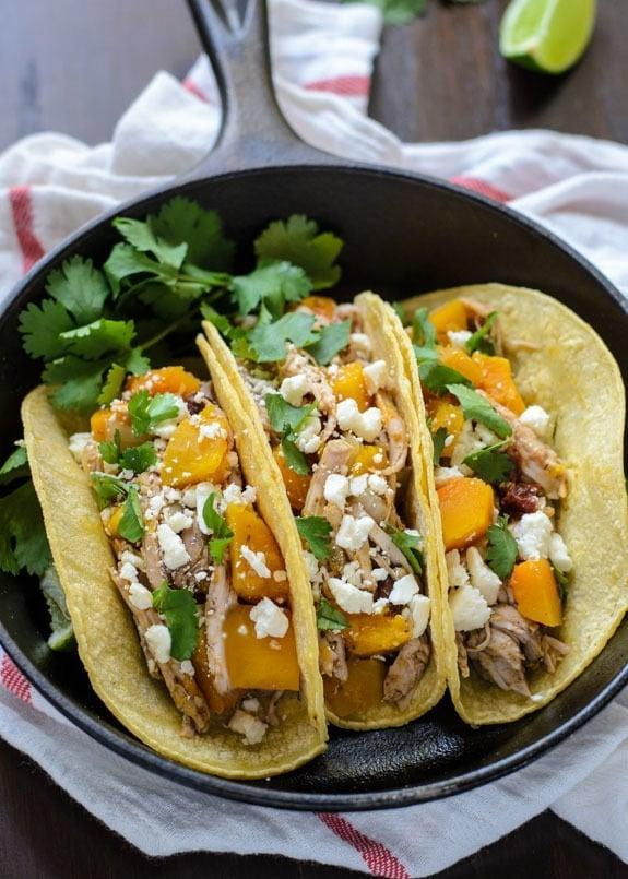 """<p>Tacos may not be the first thing you think of when fall pops in your head, but Taco Tuesday still has to happen, right? After all, if it has squash in it, it is autumnal enough. </p> <p><strong>Get the recipe here:</strong> <a href=""""http://www.wellplated.com/slow-cooker-butternut-squash-pulled-pork-tacos/"""" class=""""link rapid-noclick-resp"""" rel=""""nofollow noopener"""" target=""""_blank"""" data-ylk=""""slk:slow-cooker butternut squash pulled pork tacos"""">slow-cooker butternut squash pulled pork tacos</a></p>"""