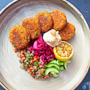 """<p>Falafel is a traditional Middle-Eastern dish typically made with ground <a href=""""https://www.delish.com/uk/cooking/recipes/a29843193/mediterranean-chickpea-salad-recipe/"""" rel=""""nofollow noopener"""" target=""""_blank"""" data-ylk=""""slk:chickpeas"""" class=""""link rapid-noclick-resp"""">chickpeas </a>or broad beans. They're usually deep-fried but can be backed in the oven, too.</p><p>Get the <a href=""""https://www.delish.com/uk/cooking/recipes/a32220420/sweet-potato-falafel/"""" rel=""""nofollow noopener"""" target=""""_blank"""" data-ylk=""""slk:Sweet Potato Falafel"""" class=""""link rapid-noclick-resp"""">Sweet Potato Falafel</a> recipe.</p>"""