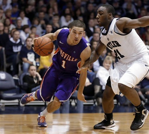 Evansville guard Colt Ryan, left, goes around Butler forward Roosevelt Jones during the second half of an NCAA college basketball game, Saturday, Dec. 22, 2012, in Indianapolis. Butler won 75-67. (AP Photo/AJ Mast)