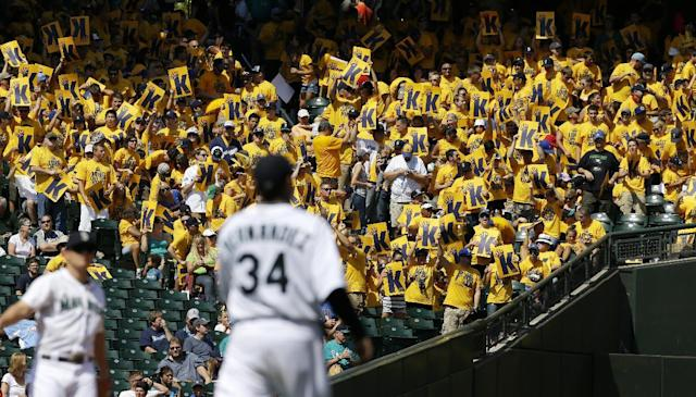 "Fans in the ""Kings Court"" section cheer for Seattle Mariners starting pitcher Felix Hernandez (34) after a strikeout in the fifth inning of a baseball game against the Milwaukee Brewers, Sunday, Aug. 11, 2013, in Seattle. (AP Photo/Ted S. Warren)"