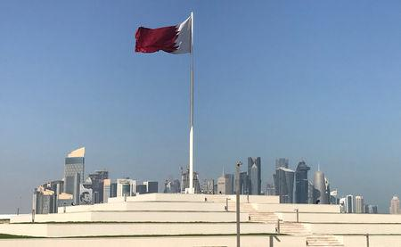 The Qatari flag is seen at a park near Doha Corniche, in Doha