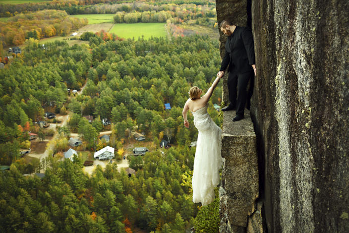 James and Melissa take a daring wedding photo. (Photo: Jay Philbrick/Caters News)