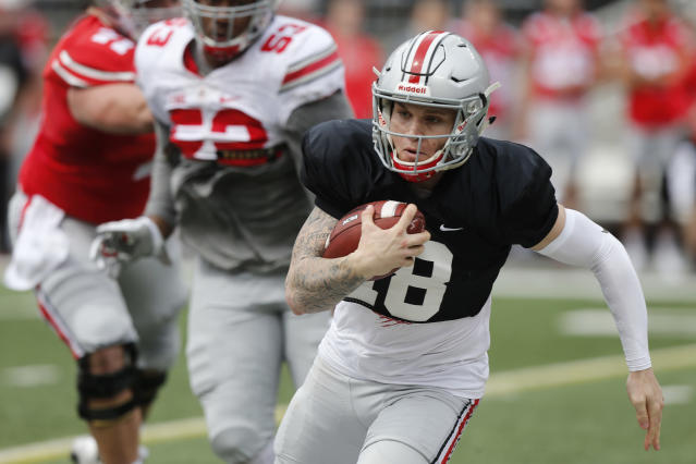 Ohio State quarterback Tate Martell scrambles in the backfield during their NCAA college spring football game Saturday, April 14, 2018, in Columbus, Ohio. (AP Photo/Jay LaPrete)