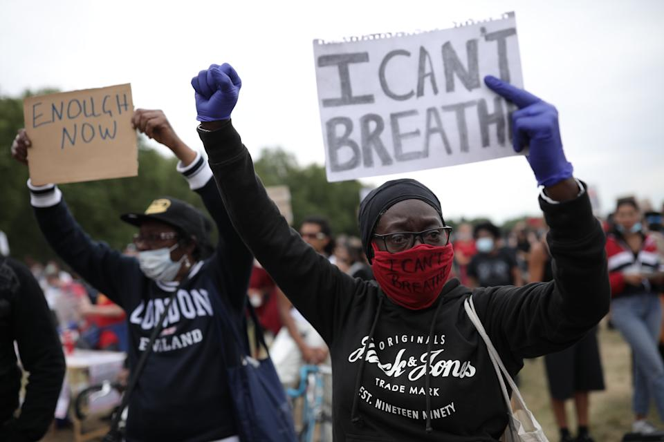 LONDON, ENGLAND - JUNE 03: A protester wearing a face mask holds a sign saying 'I can't breathe' during a Black Lives Matter protest in Hyde Park on June 3, 2020 in London, United Kingdom. The death of an African-American man, George Floyd, while in the custody of Minneapolis police has sparked protests across the United States, as well as demonstrations of solidarity in many countries around the world. (Photo by Dan Kitwood/Getty Images)