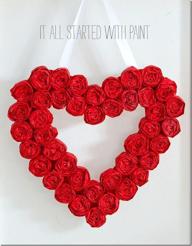 """<p>Pretty as a picture, this wreath is crafted from 40 or so rosettes made out of tissue paper leftover from Christmas.</p><p><strong>Get the tutorial at <a href=""""https://www.itallstartedwithpaint.com/valentine-wreath/"""" rel=""""nofollow noopener"""" target=""""_blank"""" data-ylk=""""slk:It All Started with Paint"""" class=""""link rapid-noclick-resp"""">It All Started with Paint</a>.</strong></p><p><a class=""""link rapid-noclick-resp"""" href=""""https://www.amazon.com/s?k=hot+glue+gun&tag=syn-yahoo-20&ascsubtag=%5Bartid%7C10050.g.35057743%5Bsrc%7Cyahoo-us"""" rel=""""nofollow noopener"""" target=""""_blank"""" data-ylk=""""slk:SHOP HOT GLUE GUNS"""">SHOP HOT GLUE GUNS</a><br></p>"""