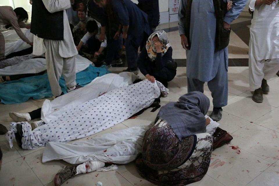 Relatives mourn victims who died in a blast outside a school in the west Kabul district of Dasht-e-Barchi in May (AFP/Getty)