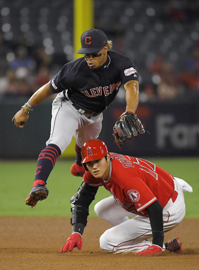 Los Angeles Angels' Shohei Ohtani, right, of Japan, looks back to first after being forced out at second, after Cleveland Indians shortstop Francisco Lindor threw out Justin Upton at first during the fourth inning of a baseball game Tuesday, Sept. 10, 2019, in Anaheim, Calif. (AP Photo/Mark J. Terrill)