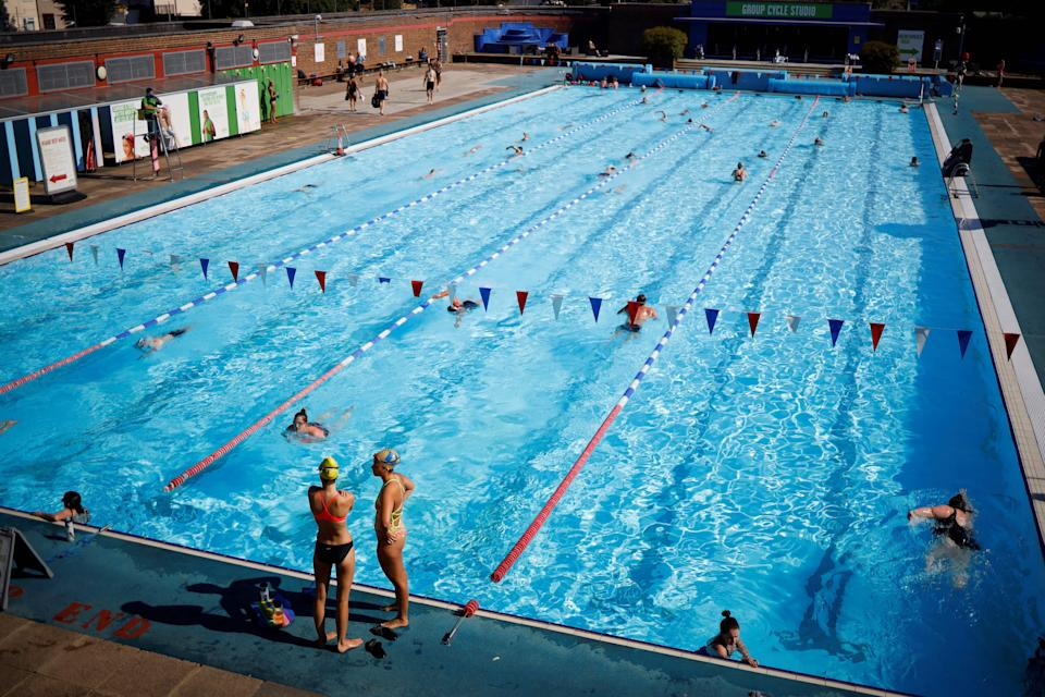 Swimmers in the sun at Charlton Lido  (AFP via Getty Images)