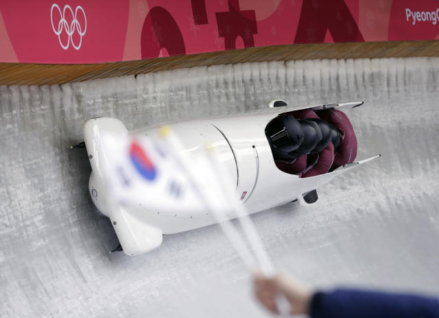 Driver Maxim Andrianov, Alexey Zaitsev, Vasiliy Kondratenko and Ruslan Samitov of the Olympic Athletes of Russia take a curve on the first day of four-man bobsled competition at the 2018 Winter Olympics in Pyeongchang, South Korea, Saturday, Feb. 24, 2018. (AP Photo/Michael Sohn)