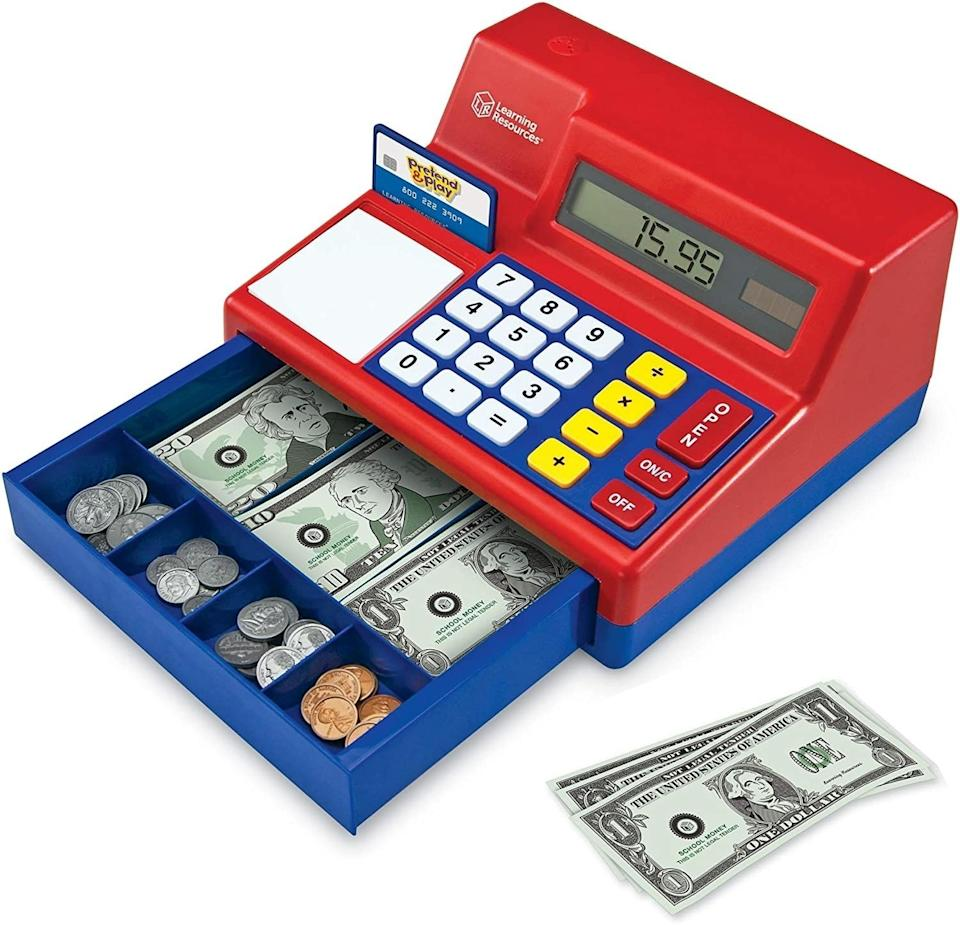 """This makes a """"cha-ching"""" noise every time it opens and will introduce concepts of math and finance to your kids, as well as possibly soon-to-be-outdated-in-their-lifetime concepts of cash and coins.<br /><br /><strong>Promising review:</strong>""""This is another great toy by Learning Resources. I bought this for my daughter when she was 2. Now 3, she still plays with it daily. She loves punching the numbers in, but her favorite part is the open button that ejects the spring-loaded drawer. She loves the paper money and the pretend credit card.<strong>I can see her and my son playing with this toy for at least ten more years. It is very durable. She has dropped it many times and it hasn't skipped a beat.</strong>The plastic is high-quality. I would definitely buy this product again."""" —<a href=""""https://amzn.to/2QJryhc"""" target=""""_blank"""" rel=""""noopener noreferrer"""">Ecinoderm4u</a><br /><strong><br />Get it from Amazon for<a href=""""https://amzn.to/3vfskBl"""" target=""""_blank"""" rel=""""noopener noreferrer"""">$34.99.</a></strong>"""