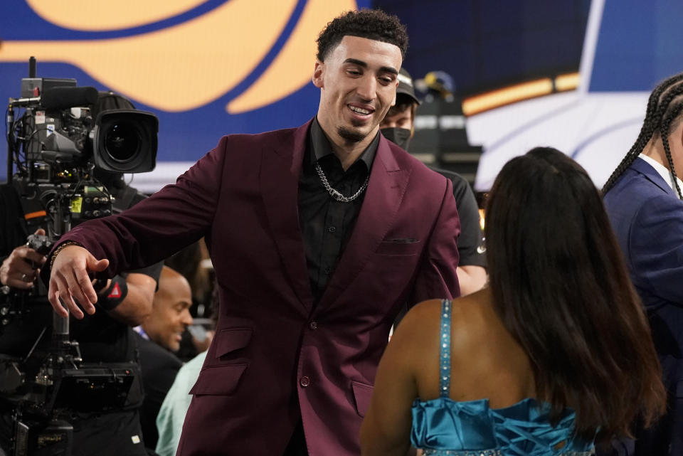 Chris Duarte, right, reacts after being selected as the 13th overall pick by the Indiana Pacers during the NBA basketball draft, Thursday, July 29, 2021, in New York. (AP Photo/Corey Sipkin)