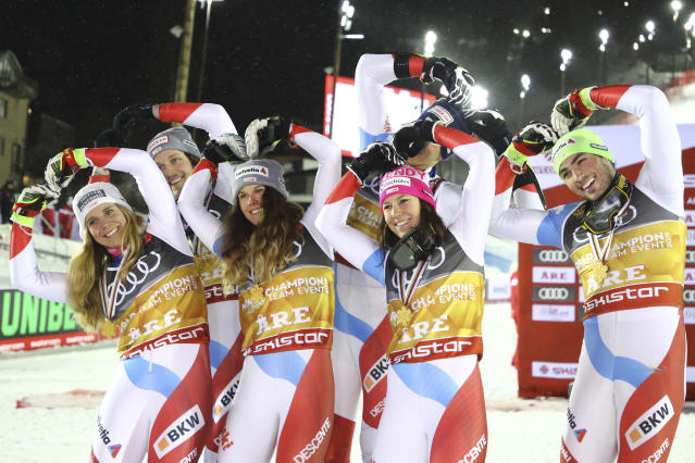 The Swiss team celebrates after winning the team event, at the alpine ski World Championships in Are, Sweden, Tuesday, Feb. 12, 2019. (AP Photo/Marco Trovati)