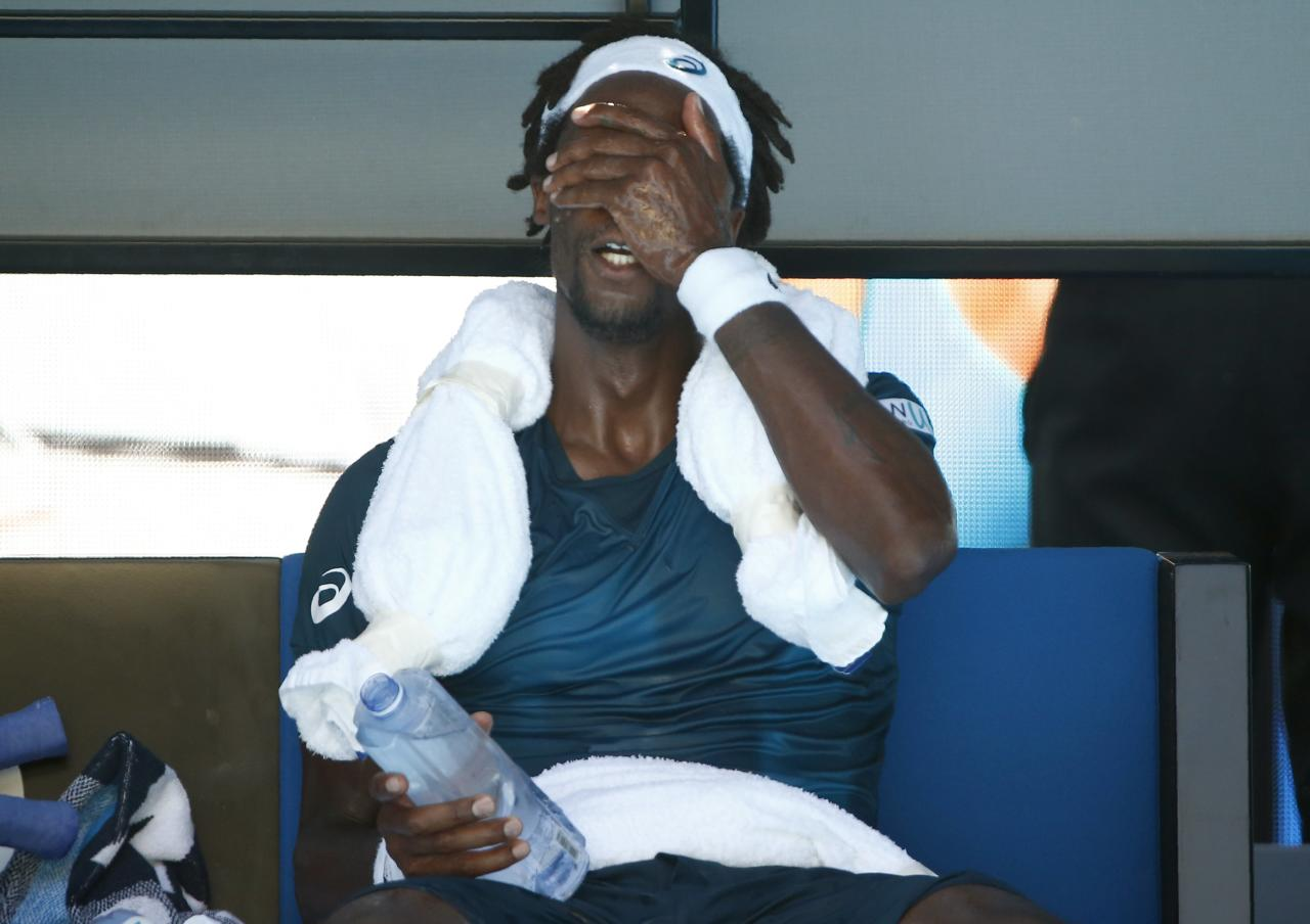 Tennis - Australian Open - Rod Laver Arena, Melbourne, Australia, January 18, 2018. Gael Monfils of France rests during a break in his match against Novak Djokovic of Serbia. REUTERS/Thomas Peter