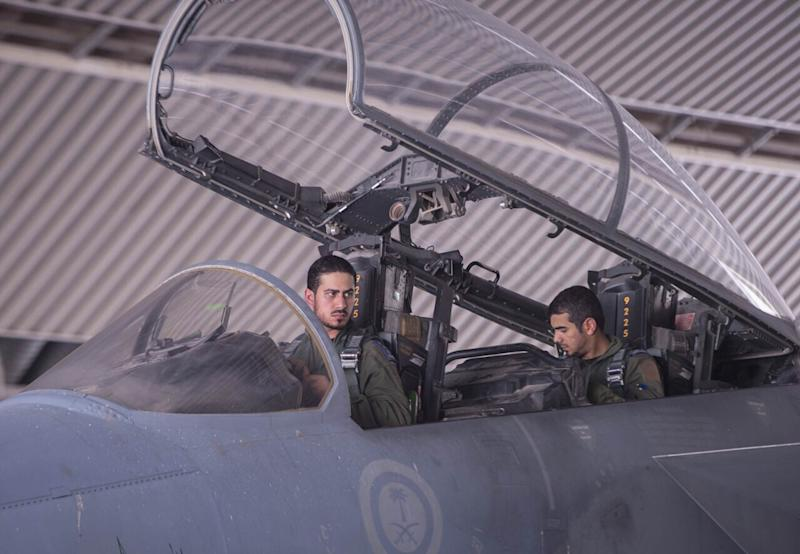 Picture released by the official Saudi Press Agency (SPA) shows Saudi Arabian air force pilots in the cockpit of a fighter jet at an undisclosed location on September 23, 2014, after taking part in a mission to strike IS group targets in Syria