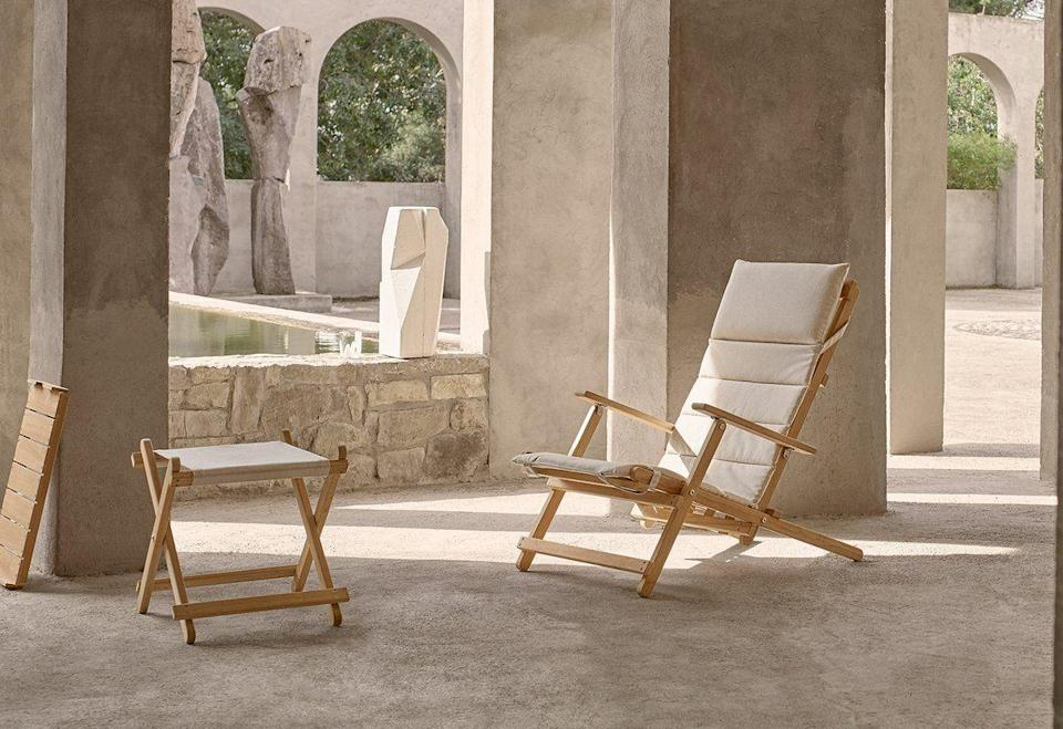 """<p>Technically more a deck chair than a sun lounger, this piece by Danish designer by Børge Mogensen – developed for his own balcony in the 1960s – is an elegant choice for sun worshippers who favour sitting over a more horizontal approach to tanning. Fold it down and it's easy to hang on a wall, making it a super choice for those short of space. £820, <a href=""""https://www.skandium.com/products/bm55565-deck-chair-with-footrest"""" rel=""""nofollow noopener"""" target=""""_blank"""" data-ylk=""""slk:skandium.com"""" class=""""link rapid-noclick-resp"""">skandium.com</a></p>"""