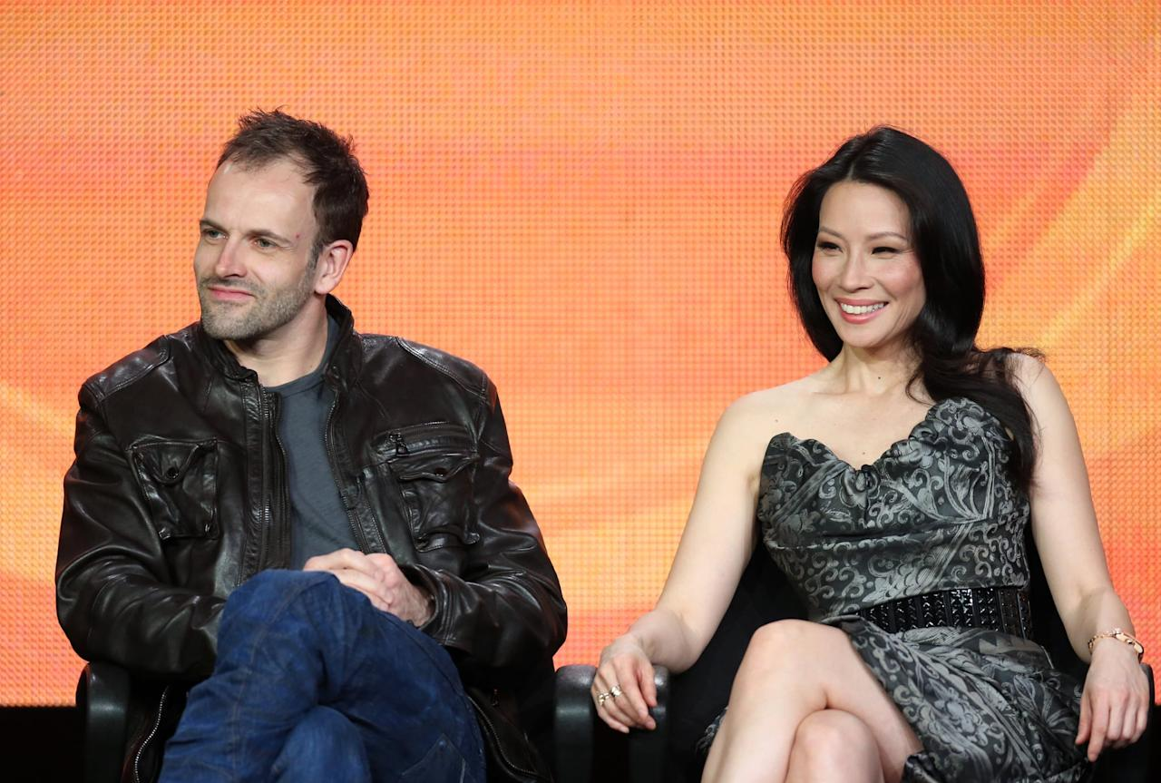 """<p>The modern take on Sir Arthur Conan Doyle's classic character stars Jonny Lee Miller as Sherlock Holmes and <a class=""""sugar-inline-link ga-track"""" title=""""Latest photos and news for Lucy Liu"""" href=""""https://www.popsugar.co.uk/Lucy-Liu"""" target=""""_blank"""" data-ga-category=""""internal click"""" data-ga-label=""""https://www.popsugar.co.uk/Lucy-Liu"""" data-ga-action=""""body text link"""">Lucy Liu</a> as a gender-swapped Dr. Joan Watson. The show follows Holmes, a recovering drug addict and former consultant to Scotland Yard, as he works with Watson and the NYPD in solving crimes throughout the series's seven seasons. </p> <p>All seven seasons of <strong>Elementary</strong> are <product href=""""https://www.hulu.com/series/elementary-4f8bc6dd-bb09-4868-a425-9c426ca7b021"""" target=""""_blank"""" class=""""ga-track"""" data-ga-category=""""internal click"""" data-ga-label=""""https://www.hulu.com/series/elementary-4f8bc6dd-bb09-4868-a425-9c426ca7b021"""" data-ga-action=""""body text link"""">available to stream on Hulu</product>.</p>"""