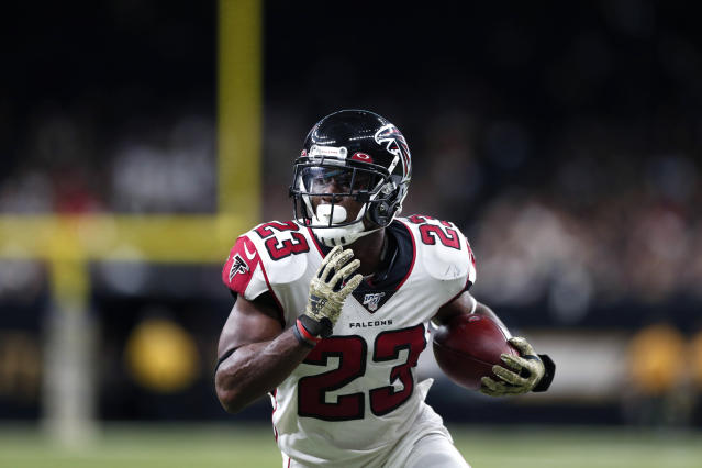 Atlanta Falcons running back Brian Hill (23) carries on a touchdown reception in the second half of an NFL football game against the New Orleans Saints in New Orleans, Sunday, Nov. 10, 2019. (AP Photo/Rusty Costanza)