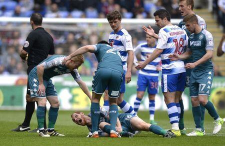 Britain Football Soccer - Reading v Wigan Athletic - Sky Bet Championship - The Madejski Stadium - 29/4/17 Wigan Athletic's Shaun MacDonald after a suspected broken leg Mandatory Credit: Action Images / Adam Holt Livepic