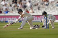 England's Joe Root plays a shot for four off the bowling of New Zealand's Mitchell Santner during the fifth day of the Test match between England and New Zealand at Lord's cricket ground in London, Sunday, June 6, 2021. (AP Photo/Kirsty Wigglesworth)