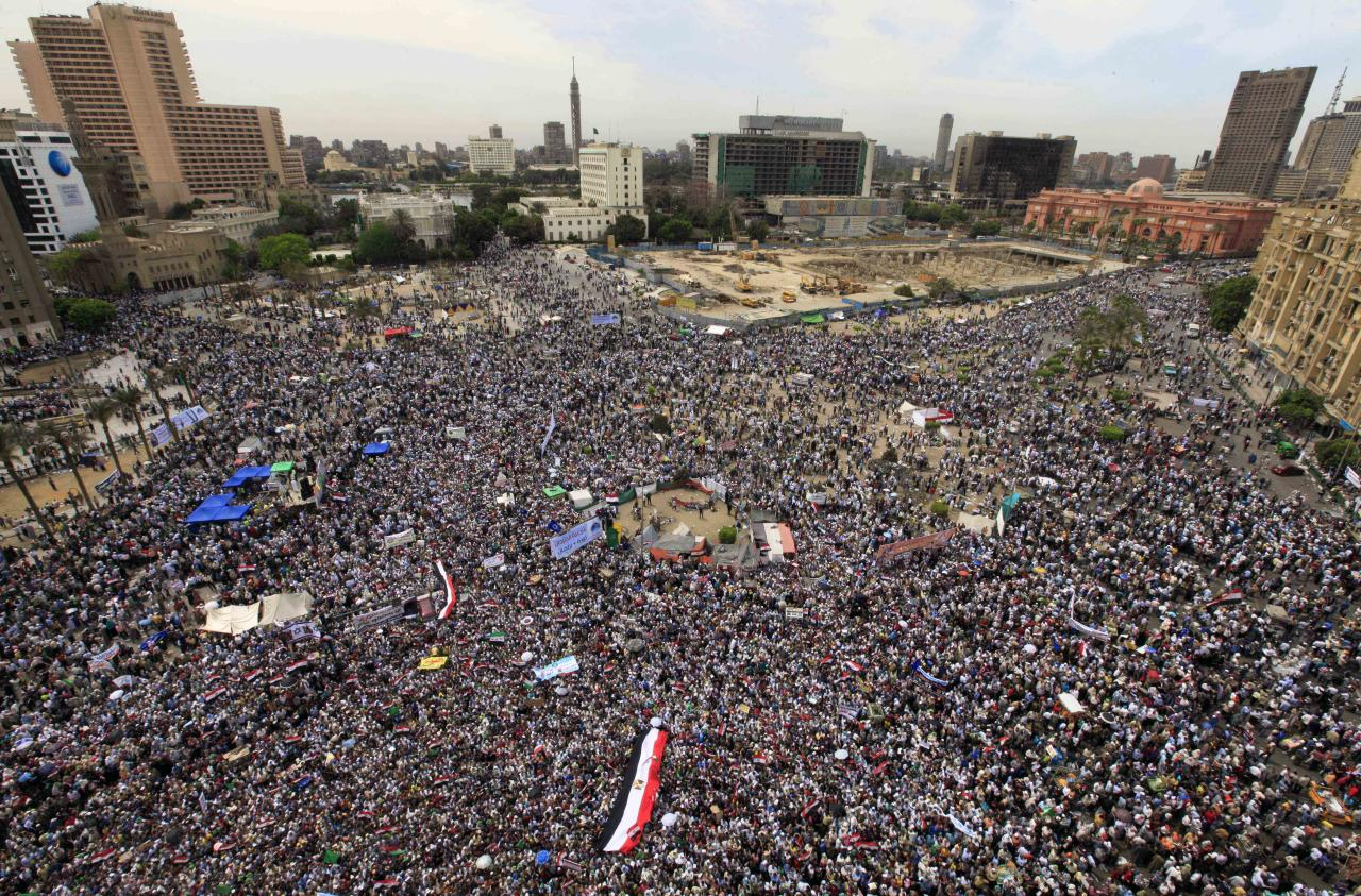 Thousands of Islamists rally in Tahrir Square to denounce the presidential candidacies of Hosni Mubarak-era officials, including that of his former spy chief, in Cairo, Egypt, Friday, April 13, 2012. Supporters of the country's most influential political group, the Muslim Brotherhood, along with ultraconservative Salafis and other Islamists packed the capital's Tahrir Square, which was the epicenter of the uprising that ousted Mubarak a year ago.(AP Photo/Amr Nabil)