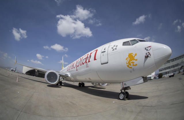 An Ethiopian Airlines Boeing 737 Max 8 sits grounded at Bole International Airport in Addis Ababa, Ethiopia Saturday, March 23, 2019. The chief of Ethiopian Airlines says the warning and training requirements set for the now-grounded 737 Max aircraft may not have been enough following the Ethiopian Airlines plane crash that killed 157 people. (AP Photo/Mulugeta Ayene)