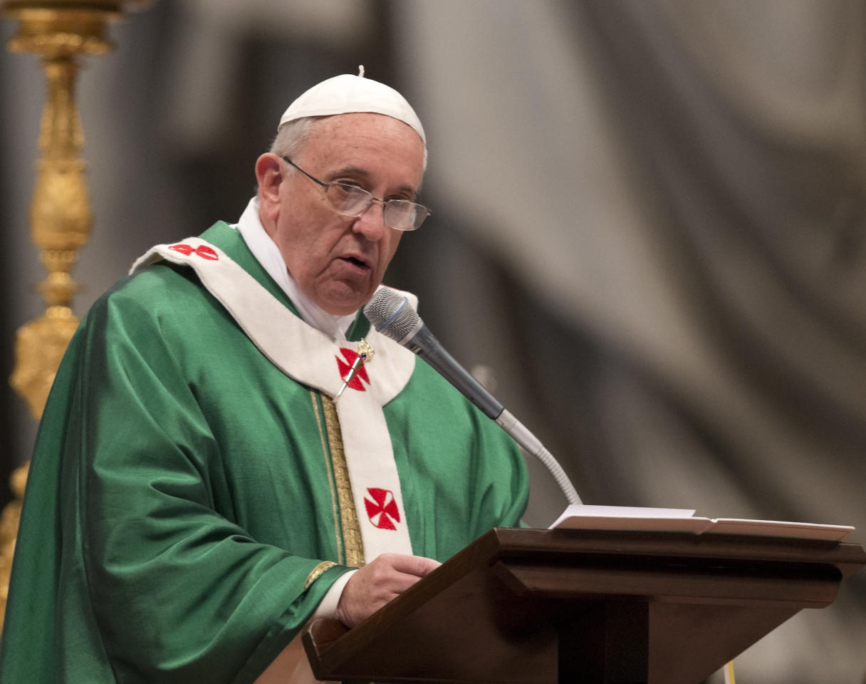 """Pope Francis delivers his speech in the St. Peter's Basilica at the Vatican, Sunday, Feb. 23, 2014. Pope Francis has given a sort of code of conduct to new cardinals, the select group of churchmen who advise him, help shape policy and elect new pontiffs. The pontiff on Sunday told the 19 men he elevated to cardinals' rank a day earlier to avoid behaving like they were in a royal court. Francis' commandments for the cardinals? """"No intrigue, gossip, power pacts, favoritism or preferentialism."""" (AP Photo/Alessandra Tarantino)"""