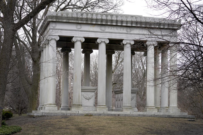 The mausoleum for Potter and Bertha Palmer, who are best known for building the Palmer House Hotel, rises high on a small hill in the deepest section of Graceland Cemetery, on Chicago's Northside Monday, March 15, 2021. Graceland quickly became the preeminent place of burial for Chicago's elite starting in the late 1800's. (AP Photo/Charles Rex Arbogast)