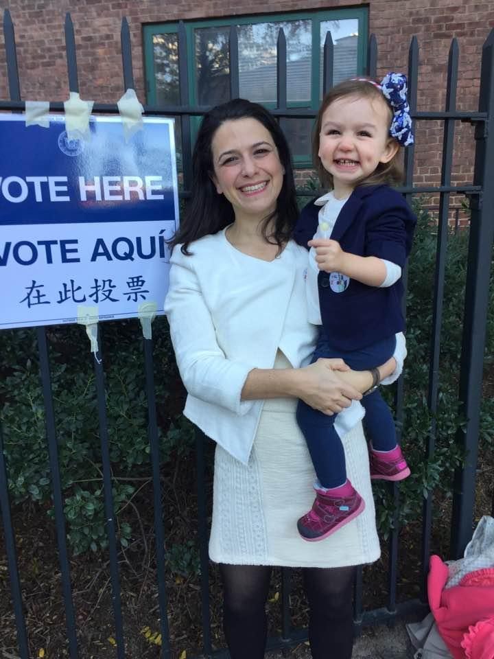 "<p>Laura Israel Sinrod of New York, New York opted for a white skirt suit for herself today — and a pantsuit for her toddler daughter. ""When I was in kindergarten, one of my favorite books was <em>Girls Can Be Anything by Norma Klein</em>,"" she tells Yahoo Style. ""I have been waiting to vote for a woman president for almost 30 years and I really hope that book will be completely outdated by the time my kids are old enough for it. I wanted to wear white in honor of the suffragettes because I really ache for the women who did not live to see this day, of course the suffragettes, but also my paternal grandmother — a Holocaust survivor who immigrated to the U.S. from a displaced person's camp with my grandfather, father, and uncle — and for my mother. My mother was so excited about Hillary but she died of lung cancer before she could cast a ballot for her. I can't believe she did not live to see a woman in the Oval Office in her lifetime. I brought my mom's white scarf and my daughter into the voting booth with me today. And my daughter, born on Election Day two years ago, has been wearing a pantsuit for a few days straight now and every time I look at her I think about how we are electing the first president she will remember [how] my grandmother, my mom, and I grew up waiting for this day, and she is the next generation to carry us forward."" (Photo: Courtesy of Laura Israel Sinrod) </p>"