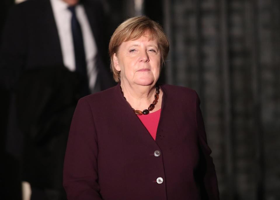 Chancellor Angela Merkel said the lockdown measures will now be extended until late December (PA)