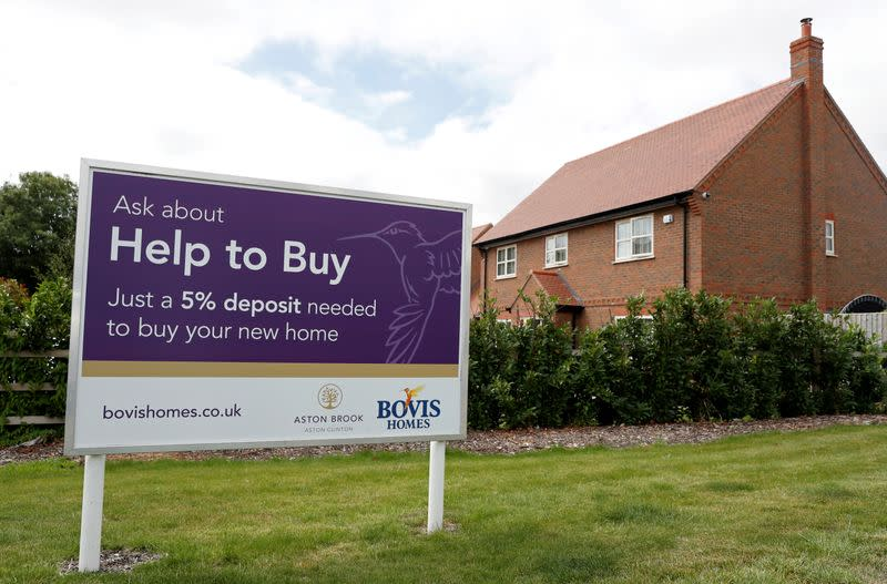 "FILE PHOTO: A ""help to buy"" sign is pictured next to new houses in Aylesbury"