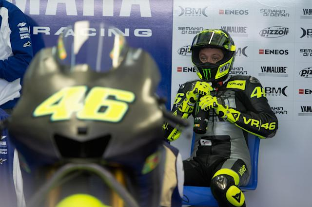 VALENCIA, SPAIN - NOVEMBER 13: Valentino Rossi of Italy and Yamaha Factory Team prepares to start in box during the first day of pre season testing of MotoGP at Ricardo Tormo Circuit on November 13, 2012 in Valencia, Spain. (Photo by Mirco Lazzari gp/Getty Images)