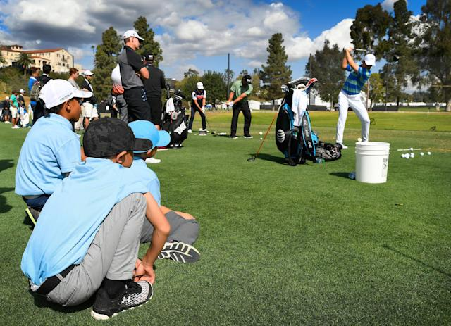 "<div class=""caption""> Three young fans watch <a class=""link rapid-noclick-resp"" href=""/pga/players/11107/"" data-ylk=""slk:Jordan Spieth"">Jordan Spieth</a> hit tee shots on the driving range during the Pro-Am round for the 2018 Genesis Open at Riviera Country Club. </div> <cite class=""credit"">Stan Badz/PGA Tour</cite>"