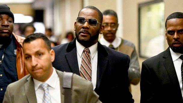 PHOTO: Musician R. Kelly, center, leaves the Daley Center after a hearing in his child support case, May 8, 2019, in Chicago. (Matt Marton/AP)