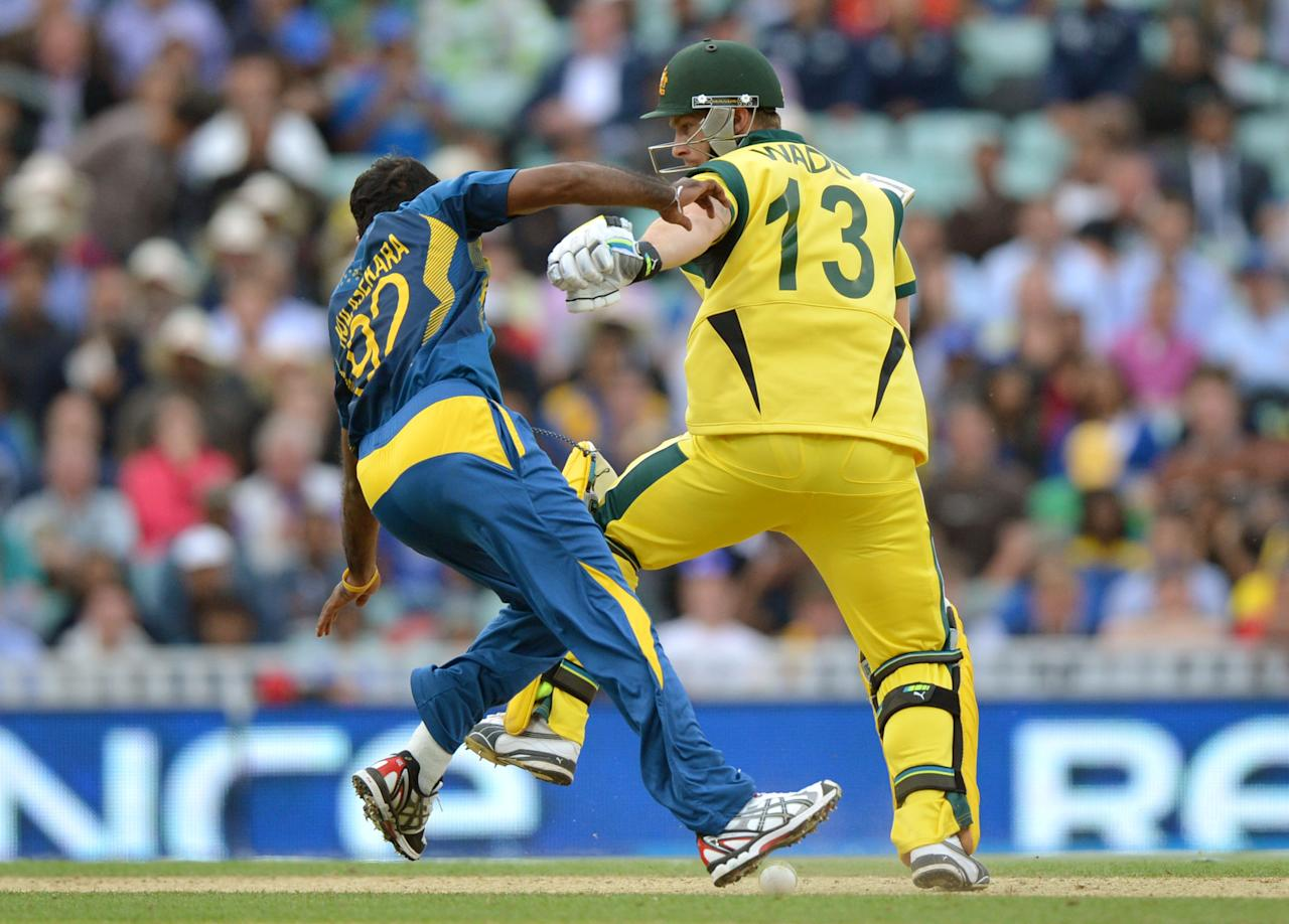 Sri Lanka's Nuwan Kulasekara (left) clashes with Australia's Matthew Wade(right) during the ICC Champions Trophy match at The Oval, London.