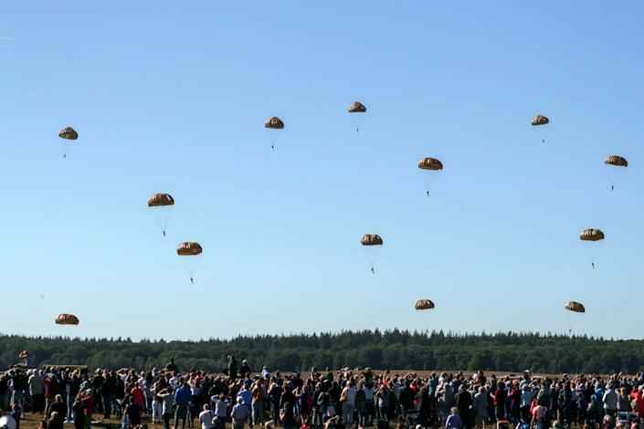 Blue skies and a large crowd at Ginkel Heath near Ede greet 1,500 paratroopers from Britain, the USA, the Netherlands and Poland: PA