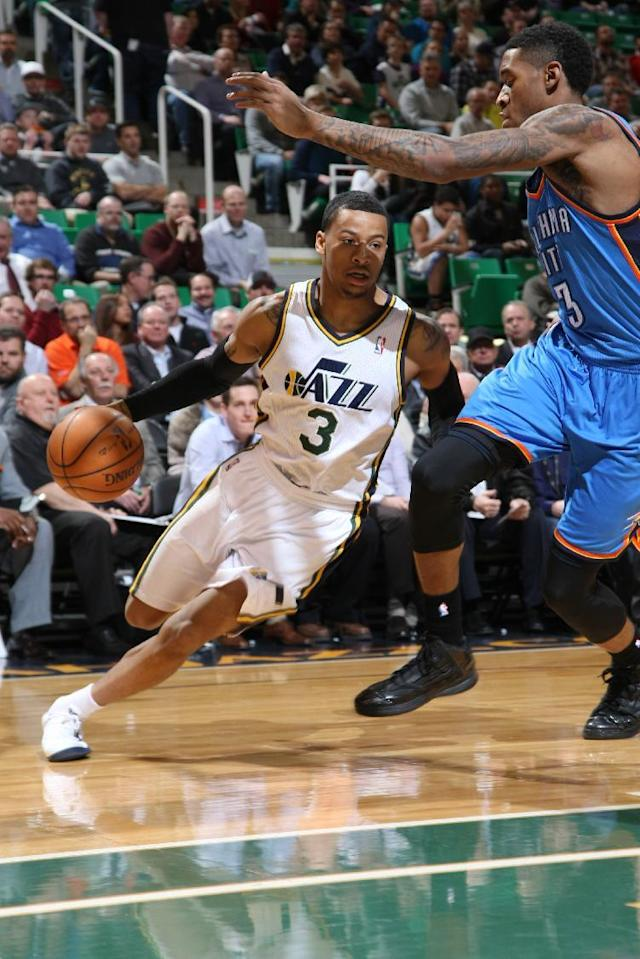 SALT LAKE CITY, UT - JANUARY 07: Trey Burke #3 of the Utah Jazz drives against Perry Jones #3 of the Oklahoma City Thunder at EnergySolutions Arena on January 07, 2014 in Salt Lake City, Utah. (Photo by Melissa Majchrzak/NBAE via Getty Images)