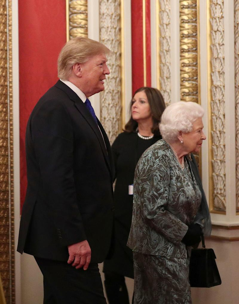 Queen Elizabeth II is accompanied by President Donald Trump at a reception she hosted at Buckingham Palace for NATO leaders, Dec. 3, 2019.