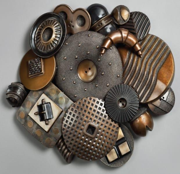 Lou Lynn said she enjoys combining glass and metals in her artwork. In 2016, she held a two-month exhibition at Nelson's Touchstones Museum of Art and History, showcasing artworks of bronze and glass inspired by buttons and kitchen utensils.