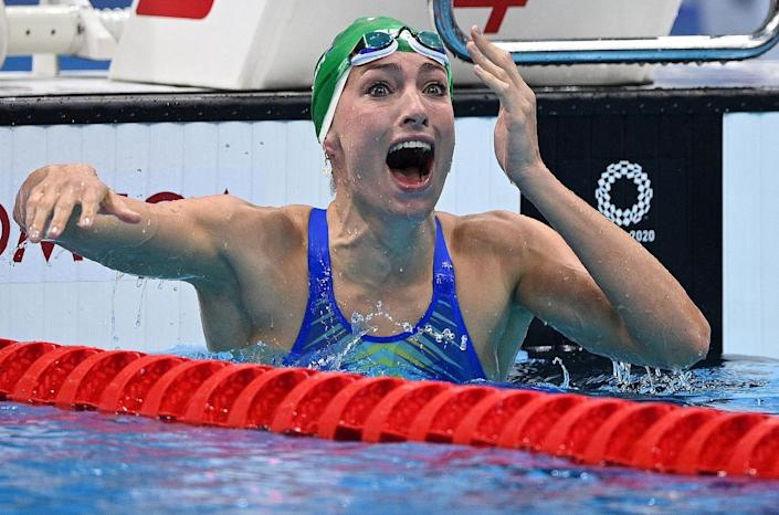 <p>South Africa's Tatjana Schoenmaker celebrates after she set a new World Record to take gold in the final of the women's 200m breaststroke swimming event.</p>