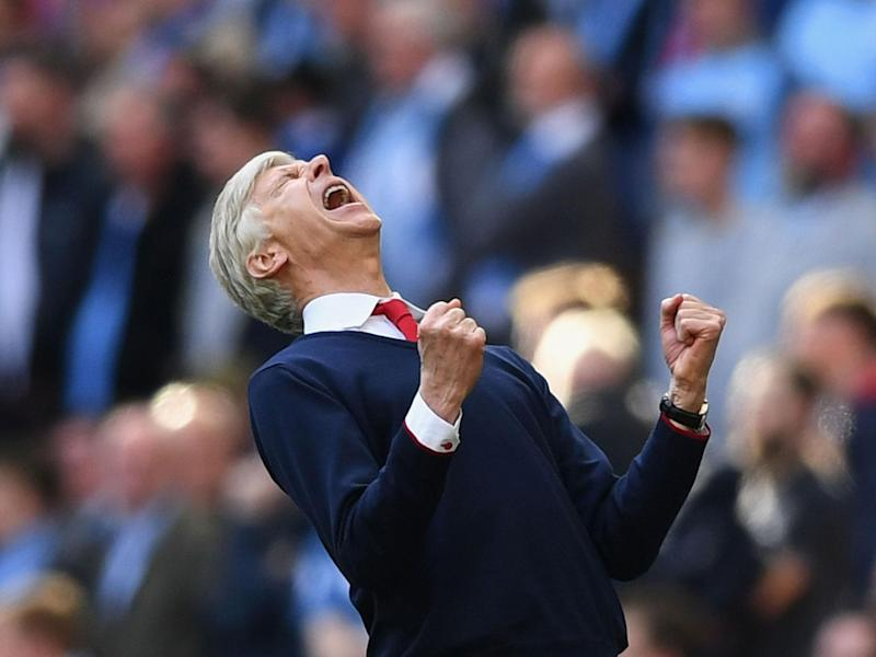 Arsene Wenger celebrates Arsenal's 2-1 FA Cup semi-final victory over Manchester City: Getty