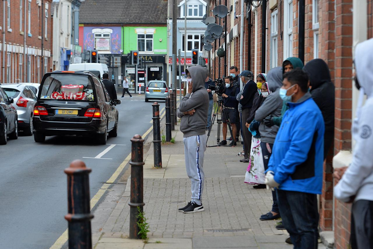 A funeral procession leaves a house on Brandon Street off Belgrave Road in the Golden Mile area of Leicester as Leicester returns to Lockdown amid a spike in Coronavirus cases in the city