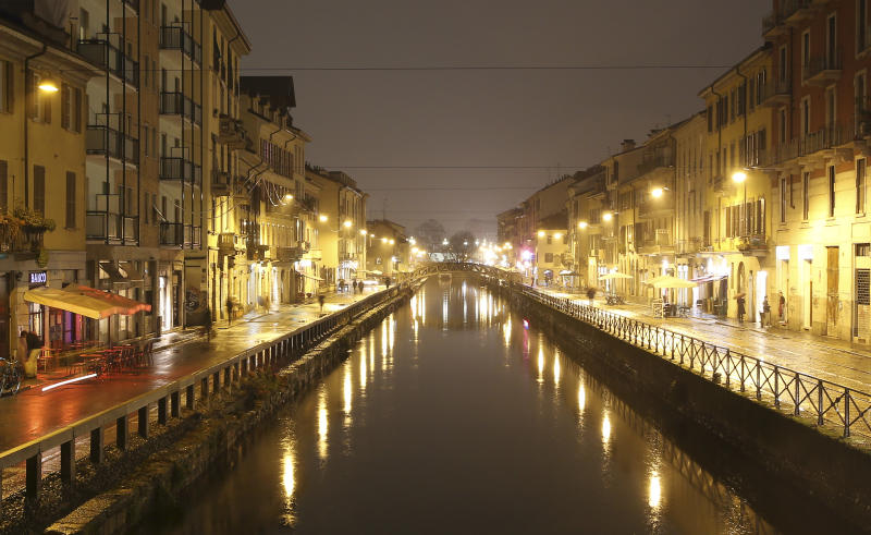 This Jan. 16, 2014 photo shows a night view of Naviglio water canal in Milan, Italy. The canals are the center of Milan's nightlife. (AP Photo/Antonio Calanni)